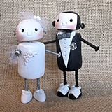 Who can resist the rosy cheeked, happy robot figurines featured in Etsy seller thejunkbucket's cake toppers ($40)?