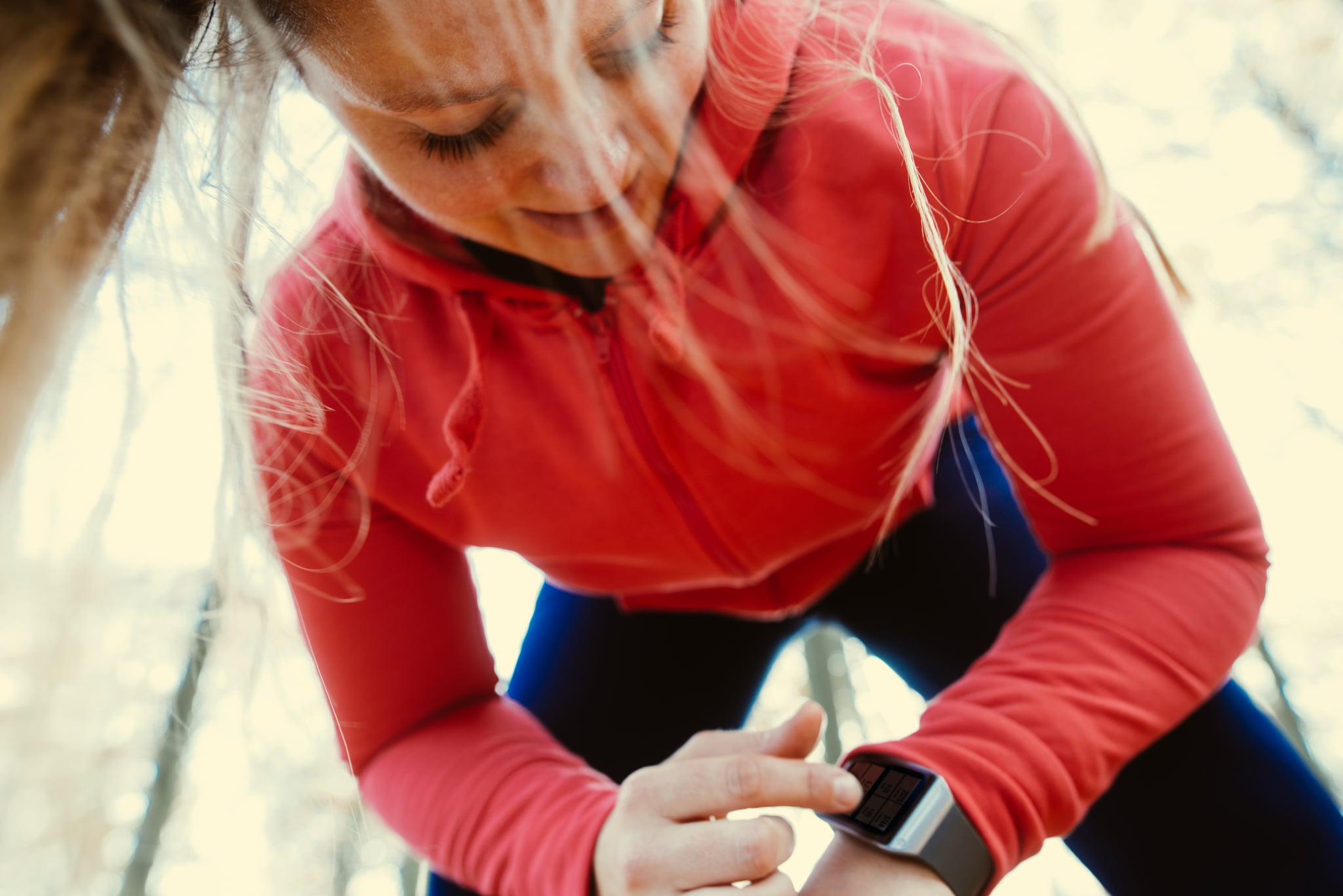 Woman using a smartwatch after jogging