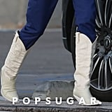 Kendall Jenner White Cowboy Boots and Adidas Track Pants