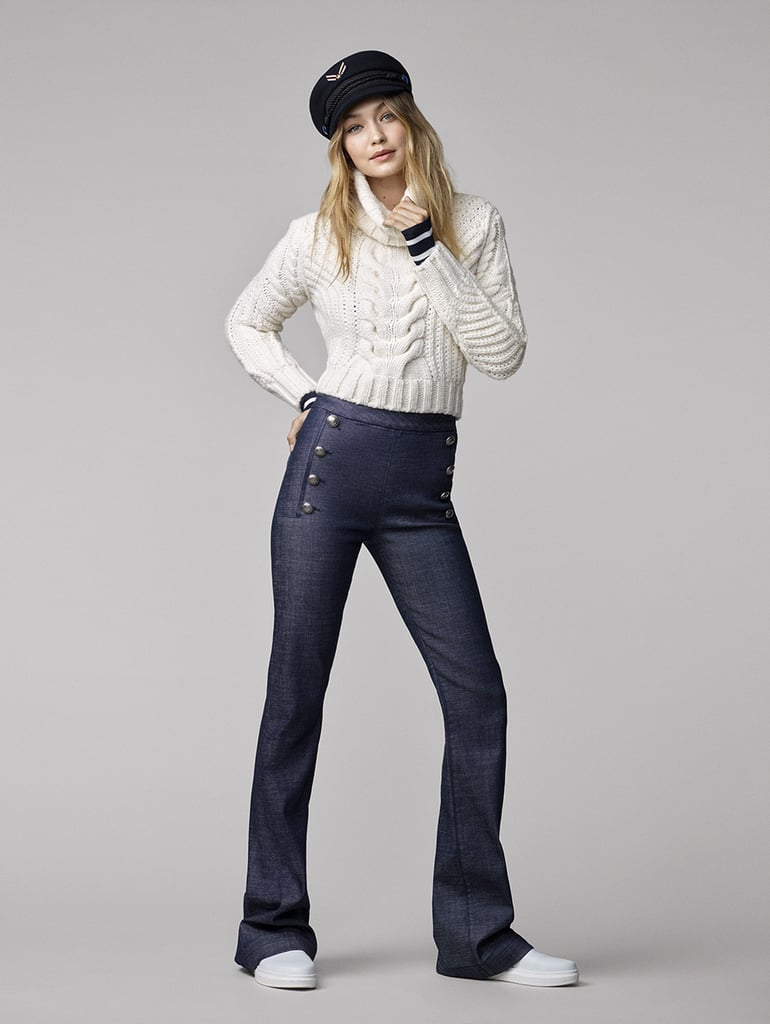 Here's Gigi in a crop cable-knit sweater with flare jeans.