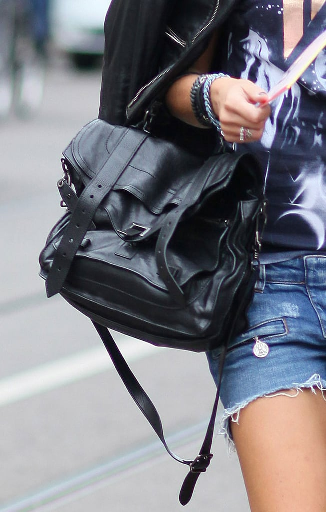 A Proenza PS1 was the polished companion to a vintage-feeling tee and cutoffs. Source: Greg Kessler