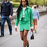 Take colored denim for a spin by teaming together a matching jacket and miniskirt.