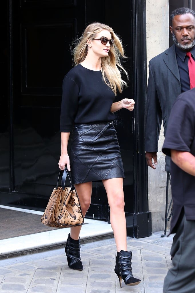 Rosie Huntington-Whiteley was spotted out and about in Paris wearing all black — including a leather mini and ankle boots — with a pop of leopard.