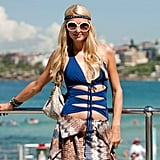 Paris Hilton wore a blue bathing suit to Bondi Beach in Australia.
