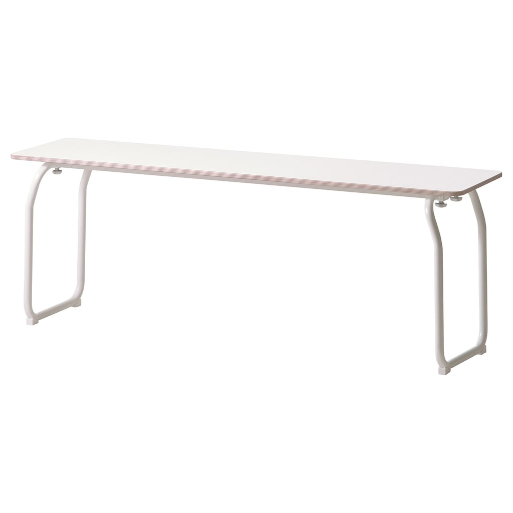 Fold up the legs and keep it with your ironing board. Ikea PS 2014 Bench ($75)