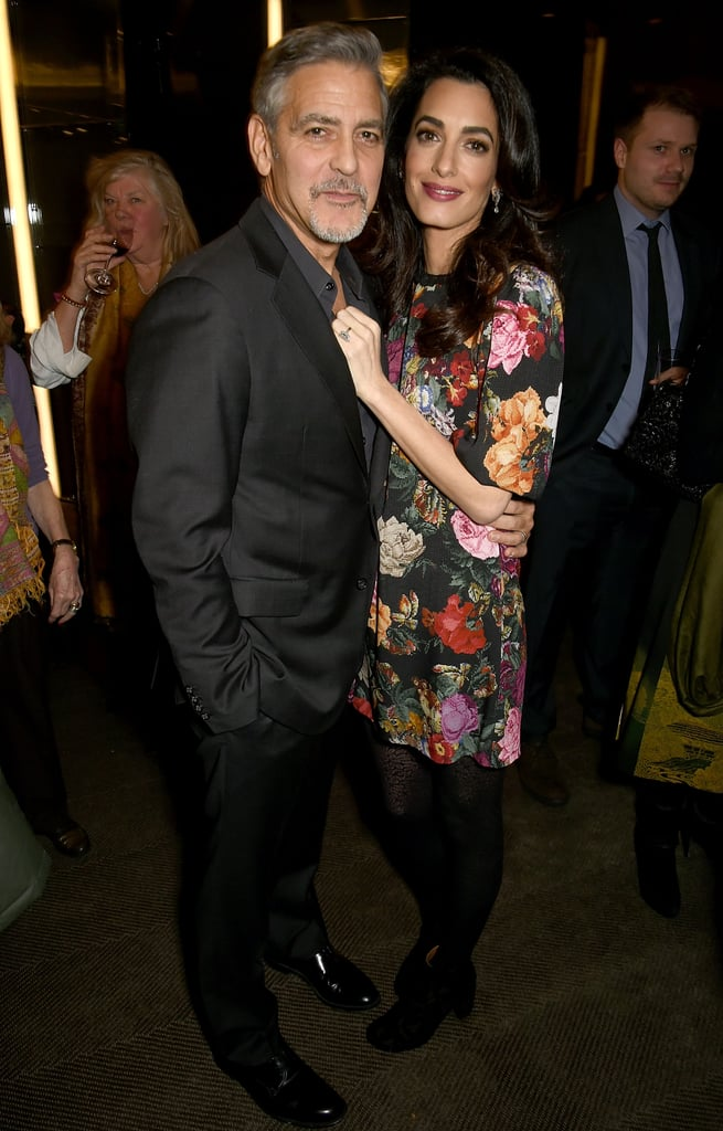 "George and Amal Clooney made a supercute pair when they attended the Netflix screening of The White Helmets hosted by The Clooney Foundation for Justice in London on Monday night. Every moment they shared while there was equally sweet, like when the duo stopped to pose for photographers and Amal placed her hand over George's chest, or when Amal stood by George's side and gazed lovingly at him. During the event, George also weighed in on Donald Trump's recent comments about his Fantastic Mr. Fox costar Meryl Streep's Golden Globes speech. In a series of tweets, the president-elect called her ""one of the most over-rated actresses,"" to which George responded, ""Aren't you supposed to be running the country?"" White Helmets is a documentary about first responders in Syria, and George is in early development on a movie version of the show."