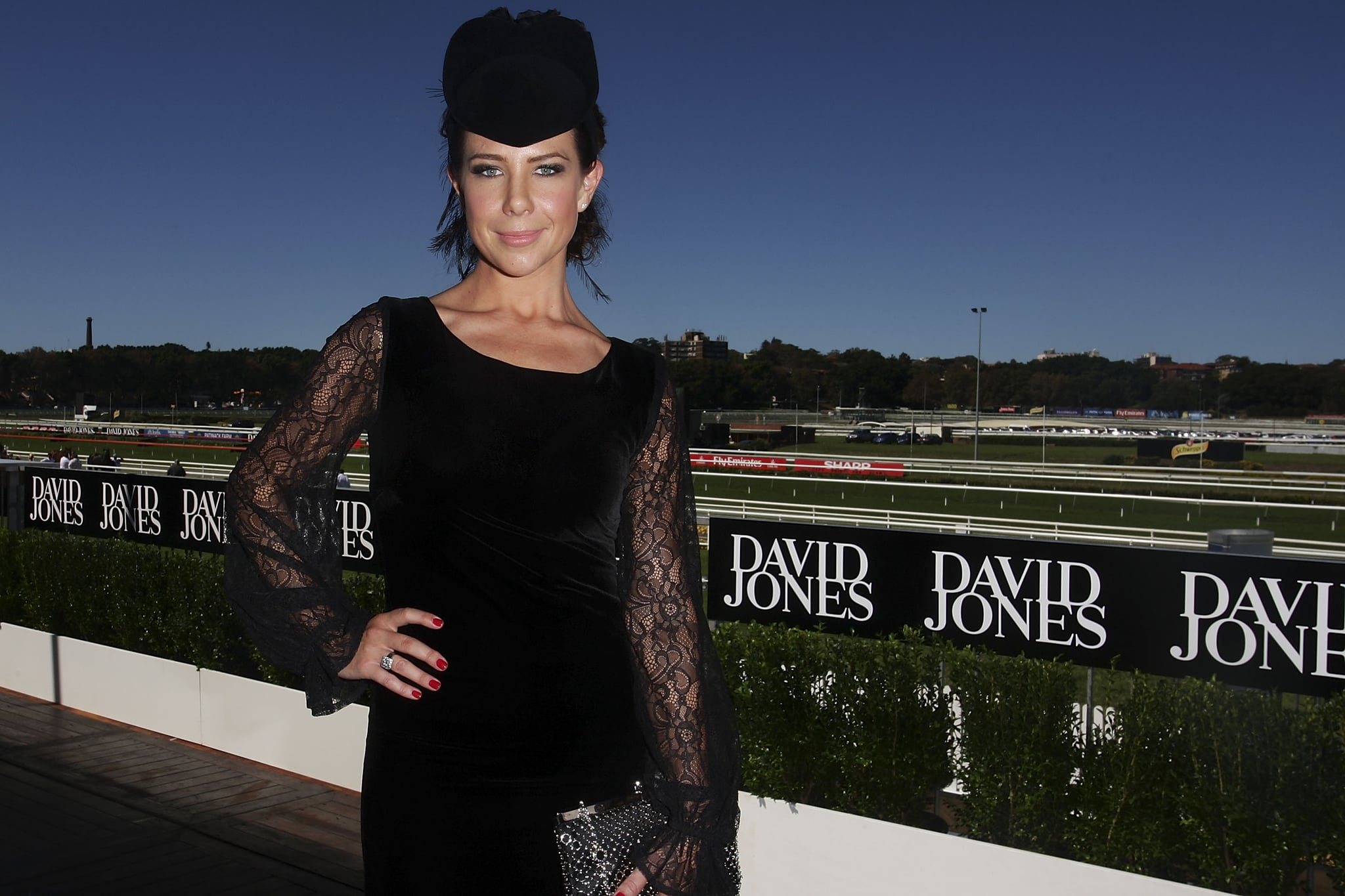 Kate Richie looked cute in a pill box hat and bell lace sleeved velvet dress.