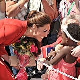 Everybody say awww! Kate Middleton looked downright delighted to accept a bouquet of flowers from this cute little girl at the Calgary Zoo in July 2011.