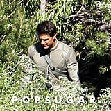 Tom Cruise hiked through the woods on the Oblivion set in CA.