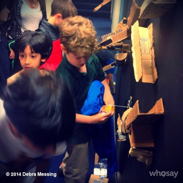 Debra Messing's son, Roman Zelman, looked intrigued by something he saw during his school's science night. Source: Instagram user therealdebramessing