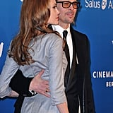 Brad Pitt put his arm around Angelina Jolie at the Cinema for Peace gala.