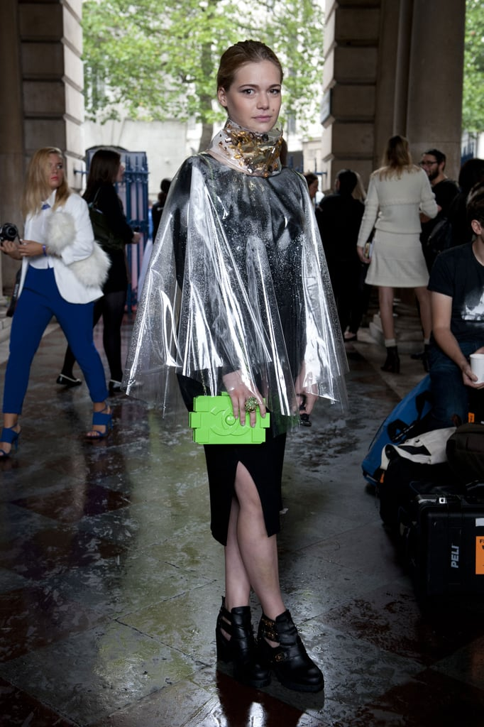 The coolest kind of rainy-day gear, complete with a neon Chanel clutch.