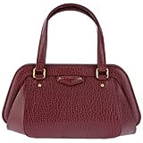 The cracked textured look and rich red hue gives this Marc by Marc Jacobs party doctor bag ($384) a total retro-chic vibe.