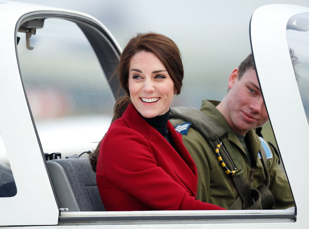 """Kate sat in the cockpit of a Grob 115E """"Tutor"""" airplane during a visit to RAF Wittering on Valentine's Day in Stamford, England."""