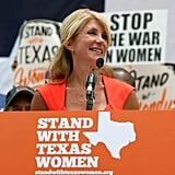Senator Wendy Davis address the crowd outside the Texas Capitol building.