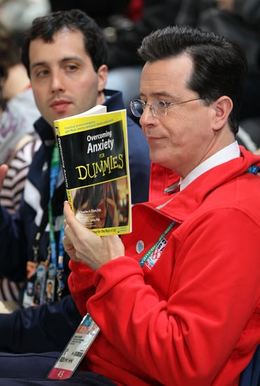 Photo of Stephen Colbert Reading Anxiety For Dummies at Olympics