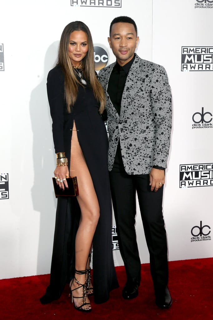 "Chrissy Teigen and John Legend drew more than a couple of stares when they hit the red carpet at the American Music Awards in LA on Monday. The model, who welcomed daughter Luna this past April, left little to the imagination in a black high-slit gown as she posed for pictures alongside her husband. John has a big night ahead of him as he's not only nominated for collaboration of the year with Meghan Trainor for their song ""Like I'm Going to Lose You,"" but he's also set to take the stage for a performance later tonight."
