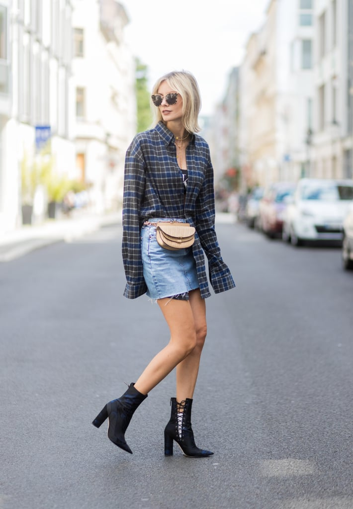 We love how this street style star tucked only half her flannel into her skirt and wore the waist-bag belt trend.
