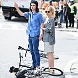 Sienna Miller and Tom Sturridge hailed a taxi next to two bikes.