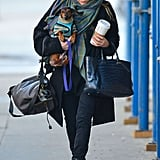 Ashley Olsen balanced her dog and coffee in NYC.
