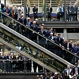 Men and women lined the balconies and escalators of the Lloyd's of London building during a service in England.