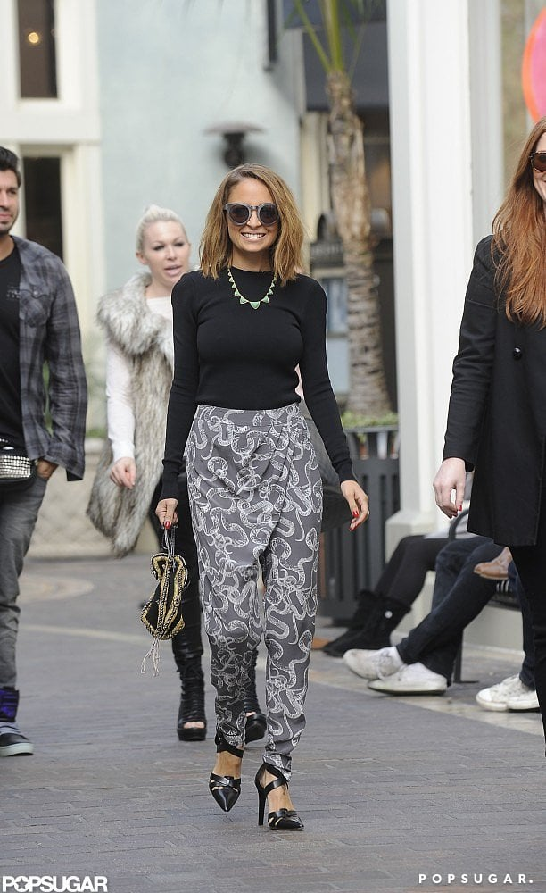 "Nicole Richie arrived at The Grove shopping mall for an appearance on Extra yesterday in LA. The mother of two wore snakeprint harem pants and a necklace from her own House of Harlow line for the stop and was seen waving to her fans as she arrived.  It's been a busy couple months for Nicole, who has been splitting her time between the gym, family, and several social and award-season events. Nicole attended the Golden Globes a few weeks ago, and while she sported long, flowing waves for the night, she more recently opted to go for a shorter new 'do. Nicole's longtime hairstylist, Andy LeCompte, showed us how to get Nicole's ""lob"" during a recent visit to our studios — check it out!"