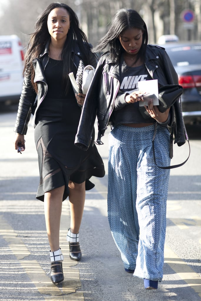 Shiona Turini made her way to the shows in a bold LBD, alongside a showgoer clad in a sporty tee and printed, floaty trousers.