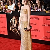 Jena Malone, aka Johanna Mason, wore a sparkly gold dress.