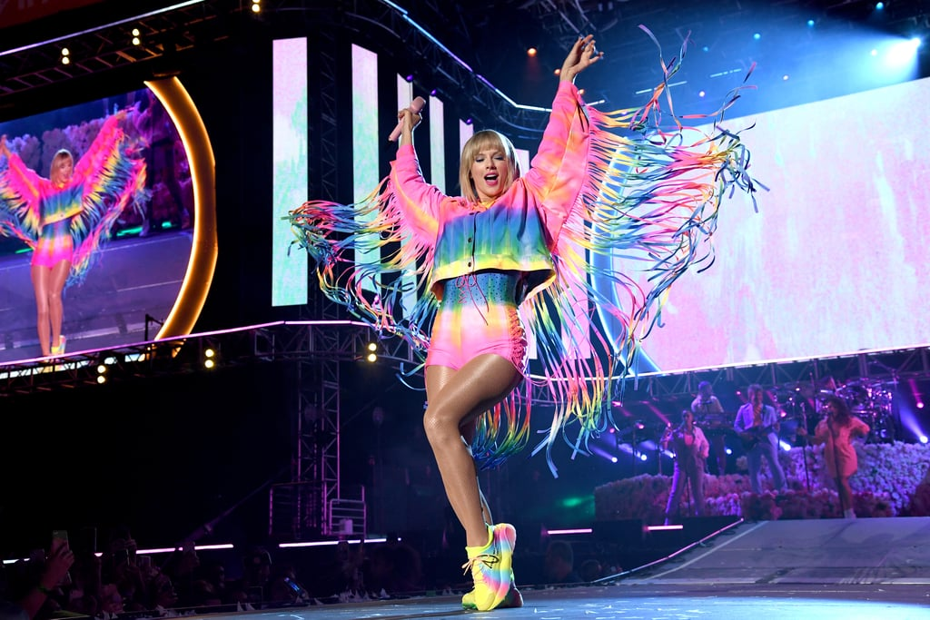 "Taylor Swift wasn't kidding when she sang about being like a rainbow with all of the colors in her latest single ""ME!"" At Saturday night's iHeartRadio Wango Tango in Los Angeles, Taylor hit the stage in a truly magical fringed, rainbow tie-dye look, and the only thing more epic was her actual performance.  Less than a year after coming off her Reputation Stadium Tour, I couldn't even have dreamed up the possibility of seeing the superstar perform her iconic hits like ""We Are Never Ever Getting Back Together"" and ""Love Story"" right now, in the year 2019 — but the Swift gods have truly delivered.  What a finale! #TaylorSwift #WangoTango pic.twitter.com/2eegyXFKpM — LiveXLive (@livexlive) June 2, 2019  Before kicking off a beautiful acoustic performance of ""Delicate,"" she spoke about celebrating the first day of Pride Month — and advocating for passing the Equality Act with her Change.org petition — telling the crowd, ""A lot of my songs are about love, and I just feel like, who you love and how you identify, you should be able to live your life the way you want to live your life. And you should have the same exact rights as everybody else."" After last night's incredible performance and A+ soccer skills, all there's left to do is continue the Easter egg investigation until we finally get that TS7 album announcement info. In the meantime, of course, you can obsess over all the colorful moments from her performance, ahead.      Related:                                                                                                           Taylor Swift Punting a Beach Ball on Beat During Her Performance Gave Me a Nice Chuckle"