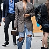 In 2017, Rihanna wore an oversize blazer and baggy jeans with furry heels. She carried a Louis Vuitton box clutch.