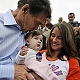 Rick Perry kisses a crying baby's head in New Hampshire.