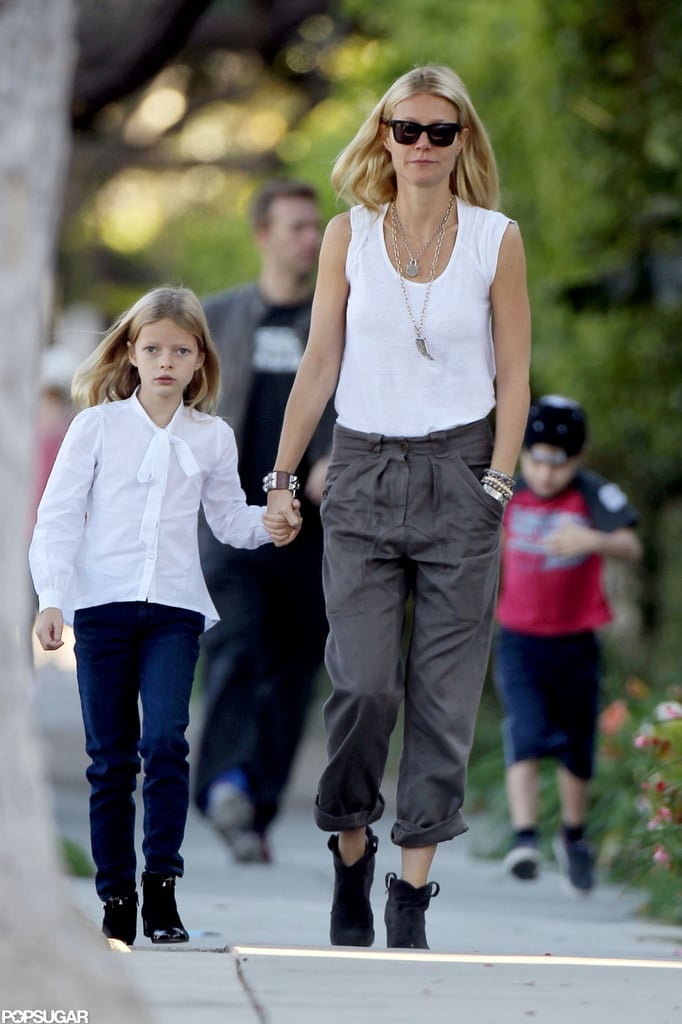 "Gwyneth Paltrow held onto her daughter Apple's hand as they walked to school in LA this morning. Chris Martin and Moses followed closely behind during the outing. The foursome has been all about family time, after Gwyneth, Chris, Apple, and Moses went shopping at Toys ""R"" Us together yesterday. They've lately been spending time stateside, where Gwyneth has also been able to meet up with friends. She grabbed dinner with Cameron Diaz earlier this week and met up with Michael Kors at an event in NYC. While she's in the US, Gwyneth is making sure to place her vote in the upcoming presidential election and tweeted a picture of her absentee ballot today."