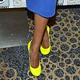 A closer look at Naya's ultrabright yellow round-toe pumps.