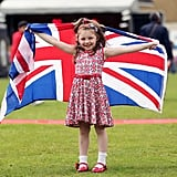 A little girl decked out in patriotic gear held a Union Jack flag in London.
