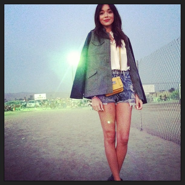 Ashley Madekwe paired a bright yellow crossbody bag with her denim cutoff and white button-up on day one of Coachella. Source: Instagram user smashleybell