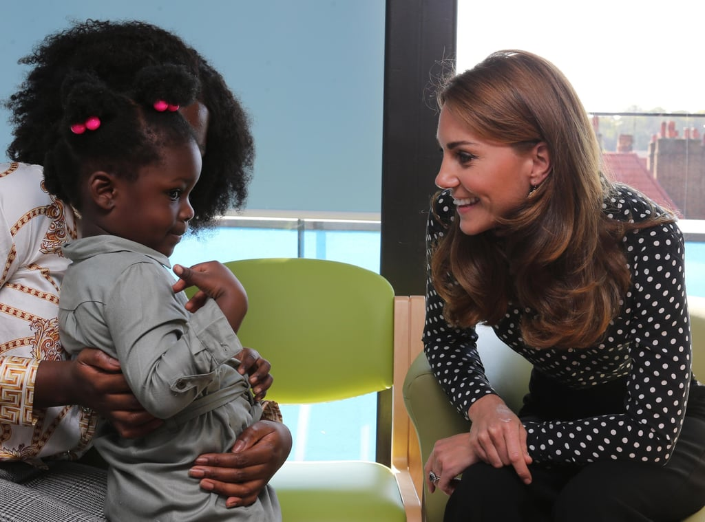 Kate Middleton is advocating for fellow parents! On Thursday, the 37-year-old royal stepped out for a surprise engagement at London's Sunshine House Children and Young People's Development Centre where she met with first-time parents. The duchess — a mother to 6-year-old Prince George, 4-year-old Princess Charlotte, and 1-year-old Prince Louis — looked cheerful as she rocked a polka dot shirt and cropped pants. During the outing, Kate learned about the voluntary home's visiting program, which services parents ages 24 and under by connecting them with a specially trained family nurse. The appointed caregiver then regularly visits the family from early pregnancy until their child is 2. Inside the centre, Kate chatted with a young girl and appeared to compliment her shirt before flashing a sweet smile. Kate — who recently finished a year-long study about the early years of childhood development — also went into mom mode while visiting RHS Garden Wisley on Sept. 10. Gathering with parents and children to encourage involvement in nature, she delighted in meeting an excited baby who welcomed her with a wide grin. She definitely has the magic motherly touch! Look ahead to view more videos and photos from her surprise trip to Sunshine House Children and Young People's Development Centre.      Related:                                                                                                           Kate Middleton Is Hitting the Ground Running in 2019 — See Her Best Moments So Far