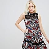 Hazel Leaf Printed High Neck Dropped Hem Dress With Lace Yolk