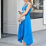 Blake Lively checked a phone while on set in NYC.