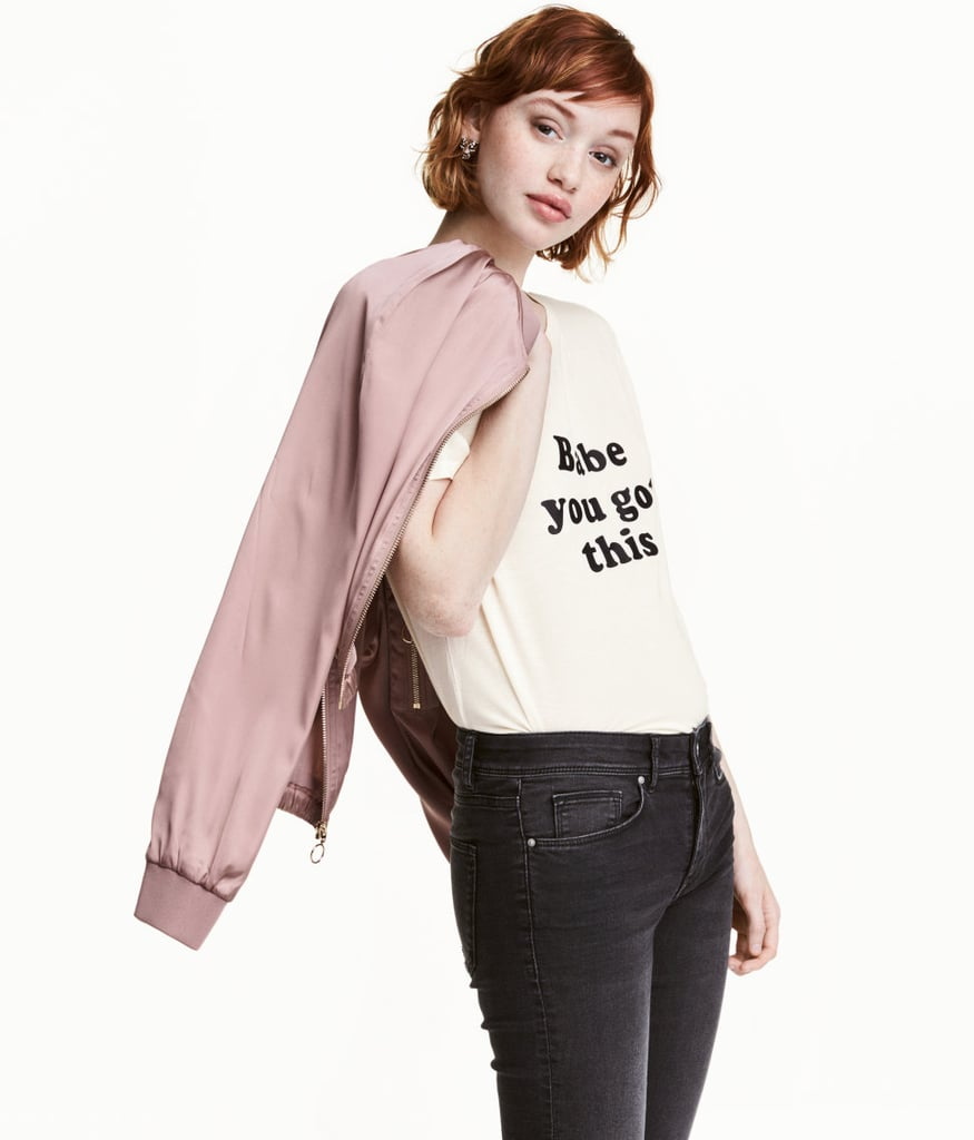 H&M's T-Shirt With Motif ($13) is a subtle call-out to the occasion with an encouraging message. You can easily pair it with your bomber and jeans any time of year.