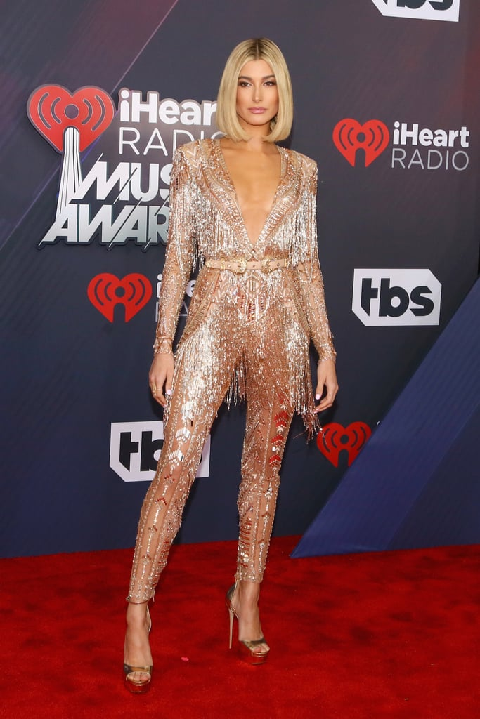 Hailey was dressed to impress when she hosted the iHeartRadio Music Awards in March. For the red carpet, she chose this stunning, fringed Zuhair Murad Spring 2018 Couture jumpsuit, capped off with Jimmy Choo platform sandals and 18k gold diamond earrings and a caviar ring from Lorraine Schwartz.