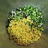 Mixing the corn black bean salad.