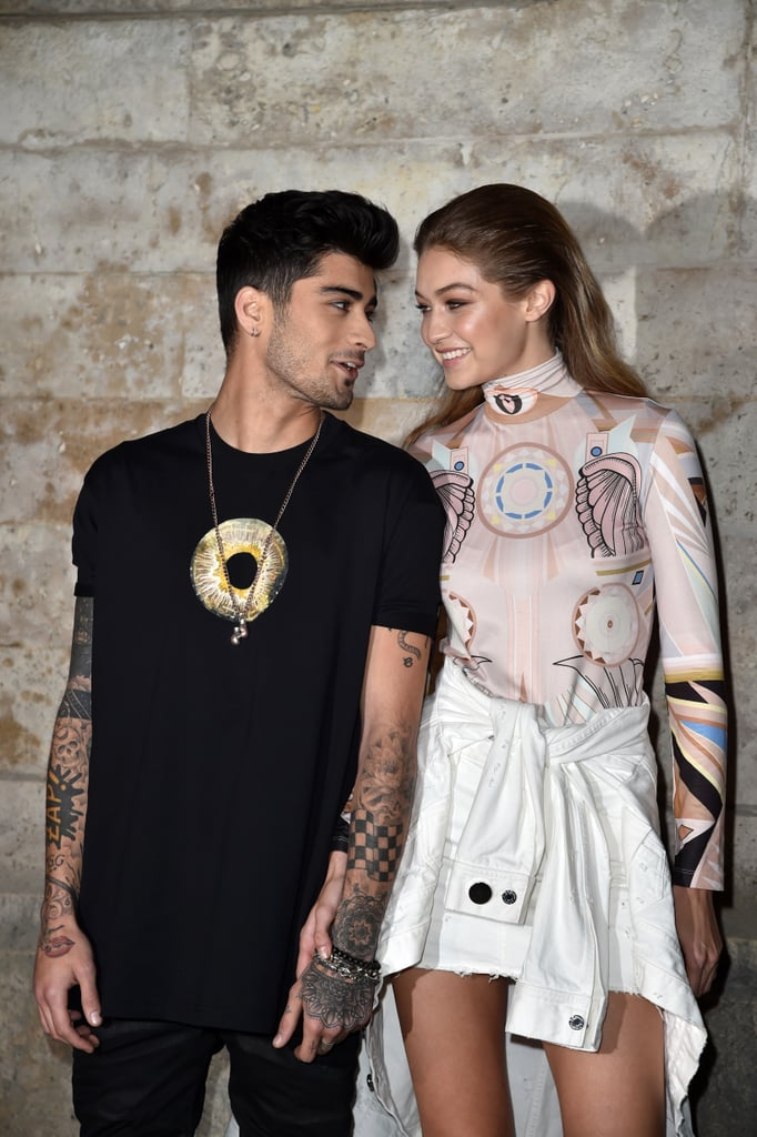 While you may get excited when your significant other takes you out to dinner, Gigi Hadid and Zayn Malik's date nights are just a tad different. On Sunday, the couple made a strikingly gorgeous appearance at Givenchy's runway presentation during Paris Fashion Week. Gigi practically glowed in a white denim skirt and printed turtleneck, while Zayn showed off his new look, which he recently debuted on Instagram. The genetically-blessed pair took in the show from the front row, where they joined pals Kim and Kourtney Kardashian, who have been taking PFW by storm.