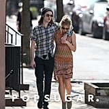 Tom Sturridge and Sienna Miller cuddled up while walking through NYC on Wednesday.