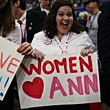 An excited women held a sign in support of Ann Romney.