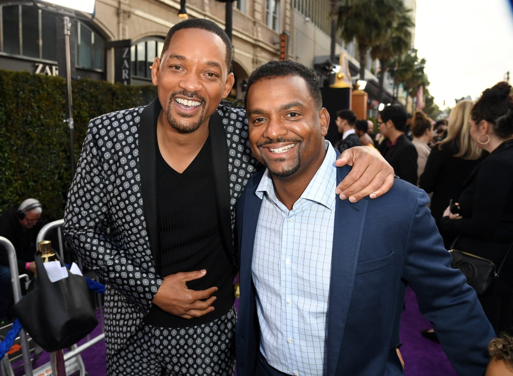 Will Smith has come a long way from his troublemaking days in West Philadelphia, but he wouldn't be where he is without his Fresh Prince of Bel-Air costars. On Tuesday night, the actor celebrated the Aladdin movie premiere in Los Angeles alongside his beautiful family, and he had his onscreen family there as well. Alfonso Ribeiro aka Carlton Banks attended the movie premiere with his adorable 5-year-old son, and Tatyana Ali (who played Ashley Banks) was there with her family as well. Tatyana had her 2-year-old son in tow, and she and Will couldn't have been happier to see each other. Somewhere, James Avery is smiling. Earlier this week, Will admitted that his role on Fresh Prince inspired the persona he gave the Genie in Disney's upcoming Aladdin movie. And we have the Genie to thank for granting us this adorable reunion! Check out Will, Alfonso, and Tatyana's photos from the premiere ahead.
