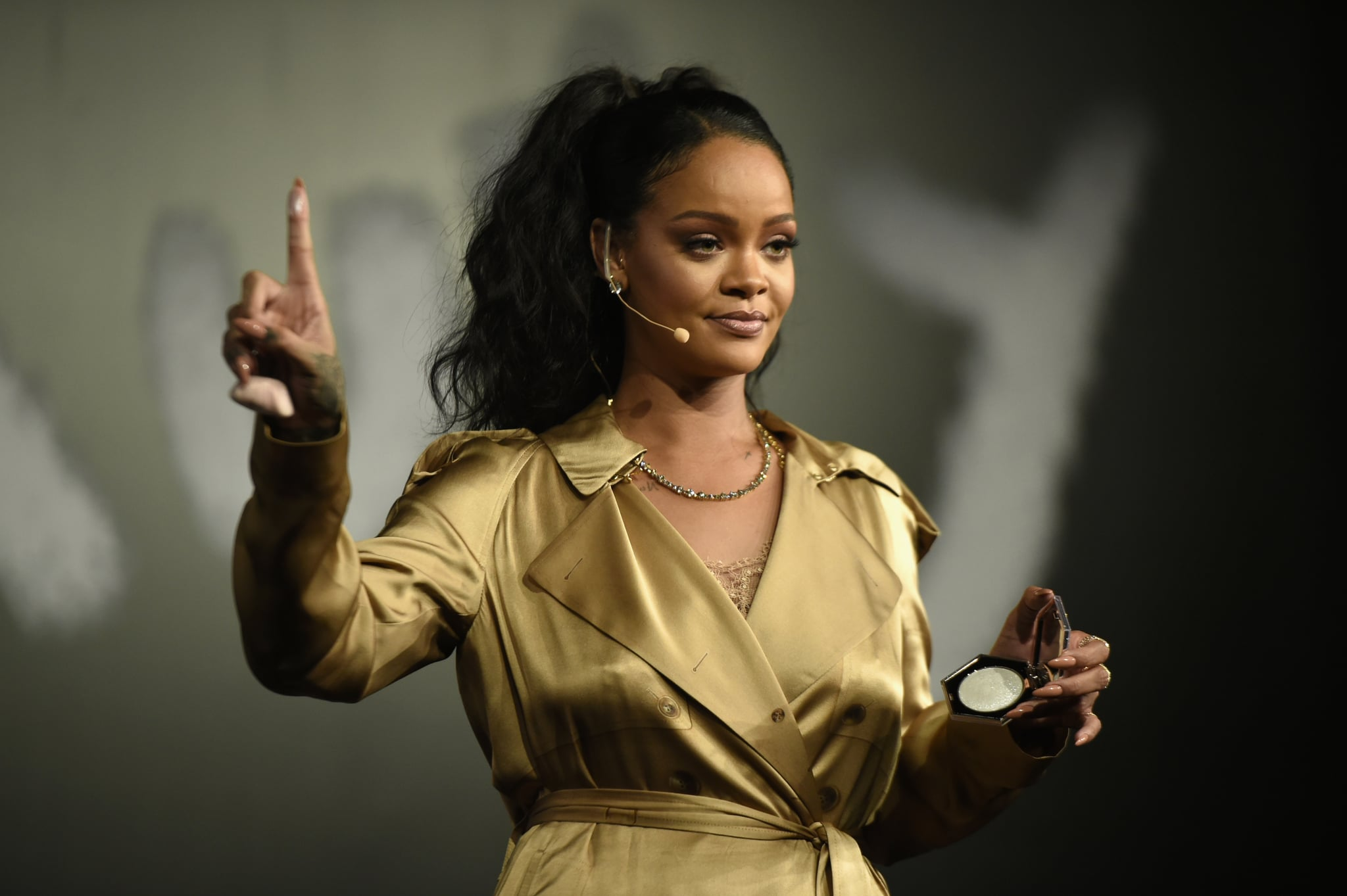 DUBAI, UNITED ARAB EMIRATES - SEPTEMBER 29:  Rihanna gestures on stage during her Fenty Beauty talk in collaboration with Sephora, for the launch of her new Stunna Lip paint