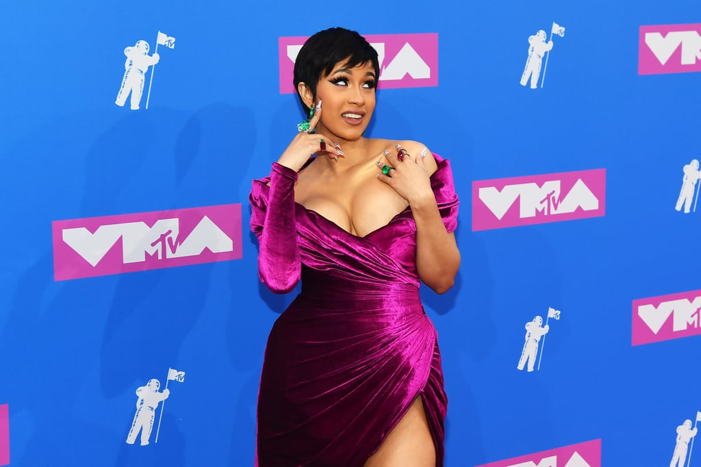 "There she is! Cardi B looked all kinds of gorgeous when she stepped out at the MTV VMAs in NYC on Monday night. The 25-year-old rapper debuted a shorter hairstyle and was positively glowing in a sexy purple dress. Cardi has a big night ahead of her; not only is it the rapper's first public appearance since she gave birth to daughter Kulture with husband Offset, but she's also leading the pack with a whopping ten nominations — eeeeooowww! Even though Cardi won't be performing tonight, she will be opening the ceremony with either a monologue or a skit.       Related:                                                                                                           Cardi B and Kehlani Get Tied Up Emotionally in the Music Video For ""Ring"""