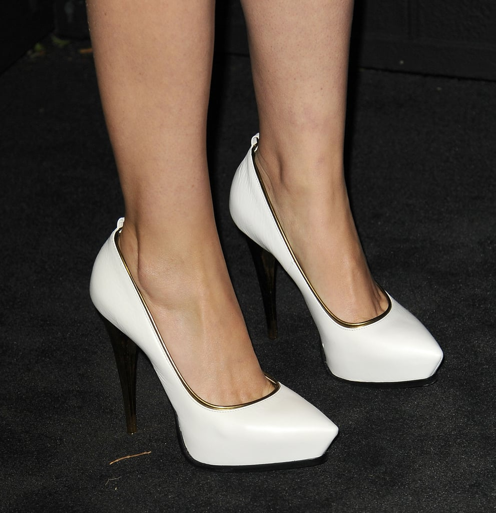 Rose Byrne contrasted the look once more with angular white Lanvin platform pumps.