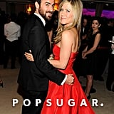 Justin Theroux and Jennifer Aniston cuddled up inside the Vanity Fair Oscar party on Sunday night after the award show.