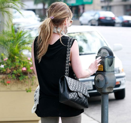 Pictures of Celebrity Feeding the Parking Meter